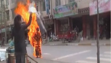 A Tibetan nun sets herself on fire in southwest China in November 2011; Still photo from video, Reuters