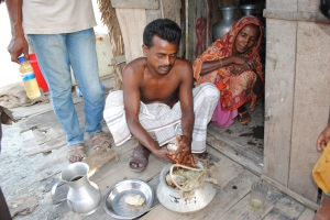 Villager shows the season's first honey harvest from the Sunderbans. Photo: Amy Yee