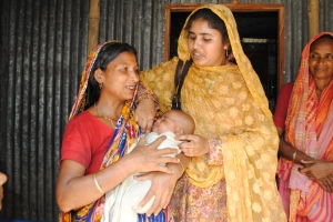 "In Dergram village in Bangladesh, health worker Shefali Akhter (right) saved this baby from asphyxia moments after delivery by the mother (left). ""The mother told me, 'You saved my child.' Now she loves me very much,"" said Shefali. Photo: Amy Yee"