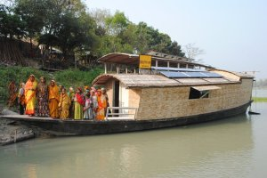 "Women gathered on a ""floating school"" operated by Shidhulai Swanirvar Sangstha, a nonprofit organization in Bangladesh, to learn about sustainable farming."