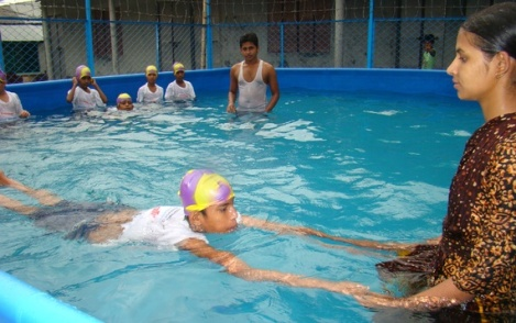 Children learning to swim in Bangladesh