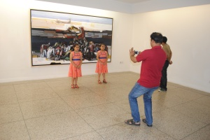 Art-goers enjoy the opening of an exhibition by artist Rafiqun Nabi at the Dhaka Art Center in Bangladesh's capital